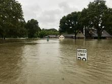 Hurricane Harvey floods a street in Spring, Texas, a community north of Houston